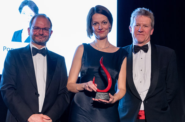 Darktrace CEO Poppy Gustafsson receives the Cambridge Judge Business School Woman Entrepreneur of the Year Award from Simon Thorpe