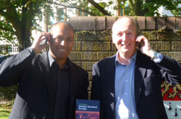 Co-authors Abhi Naha and Peter Whale with their book outside CUP