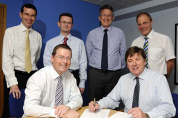 Douglas Young (front left) and Murray Graham signing the agreement with behind from left Philip Bartram and Neil Orford of Lovewell Blake and Roy Jarrold and James Banham of Banham Graham