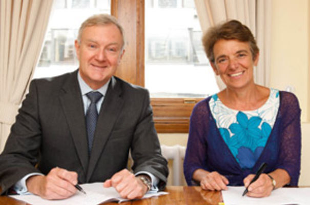 EEF chief executive, Terry Scuoler and Susan Haird, acting chief executive of UKTI signing the agreement