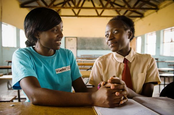 CamFed - Faith being mentored by Alice, who has taken her into her home so she can be close to school. Photo:  Eliza Powell/Camfed