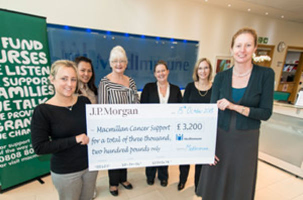 Carla Pilsworth from MacMillan Cancer Support receives MedImmune's donation from members of the MedImmune team (left to right) Apple Siladaj, Ruth Franks, Jennifer Spooner, Christel Navarro and Jane Osbourn.
