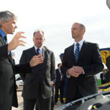 Lord Drayson, Minister for Business, Innovation and Skills, discusses CPT SpeedStart and VTES technologies with chief executive Nick Pascoe and senior manager for micro-hybrid systems Mike Dowsett.