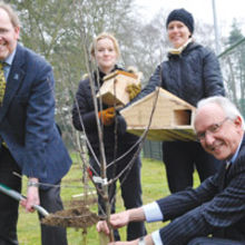 (L-R) Brian Eversham, CEO Wildlife Trust for Bedfordshire, Cambridgeshire, Northamptonshire and Peterborough; Caroline Walton, Education Editor at Cambridge University Press; Nicki Dawidowski, Community and University Executive at the Press; and Stephen Bourne, CEO of Cambridge University Press. Brian and Stephen are planting a native apple tree as part of the new orchard, with Caroline and Nicki parading a bat box and a hedgehog hotel.
