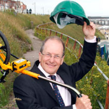 Project engineer Brian Wilkins from Canham Consulting salutes restoration work on Southwold's historic cliff-face walkway. Picture Credit  – Newsmakers PR