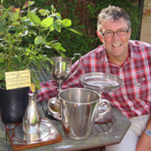 Mark Barnes, Chilford Hall's winemaker, with the array of awards