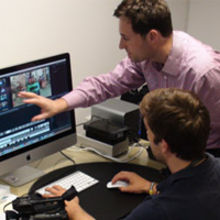 Chris Heron (standing) supervises a video production session
