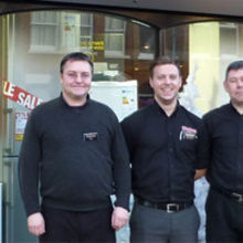 Pictured outside the new shop, left to right, Peter Rastall, Jack Phelps and David Thomas.