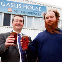 Philip Woolner and Richard Naisby (right) toasting the new Pegasus House HQ of Milton Brewery.