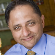 Greene King CEO Rooney Anand  - profits boosted