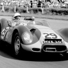 Stirling Moss winning at Silverstone in 1958 driving a Lister-Jaguar (courtesy of LAT Archive)