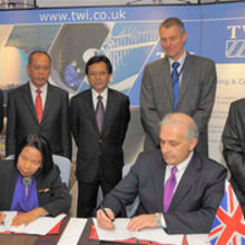 Officials representing the parties sign the MoU