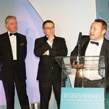 Dan Cowell (centre) and Darrin Disley of Horizon Discovery at the podium after receiving the Young Business of the Year Award from Anglian Water's Mark Pendlington (left)