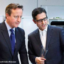 FlexEnable chairman Indro Mukerjee with PM David Cameron on a recent visit to Cambridge Science Park