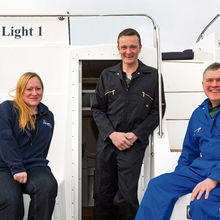 Upholsterer Fiona Powell with boat builders Nick Watts and Ian Roll aboard Dazzling Light