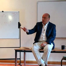 Dr Mike Lynch addresses mathematics students from Villiers Park Educational Trust