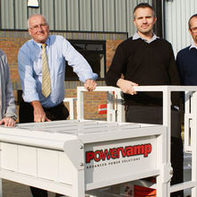Photograph shows Powervamp directors with the 'Sidewinder' system