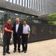 John with Yang Weiguo, president, and Fu Qiusheng, executive vice-president at Newcapec
