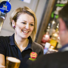 Record revenue of more than £1 billion drove record profits at Suffolk brewer and pub retailer Greene King